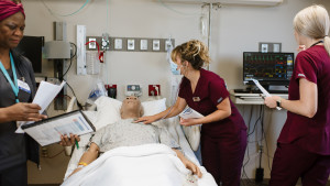 Nursing student working with simulated adult patient