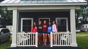 Students on tiny home porch